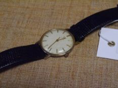 A vintage Omega gentleman's gold wristwatch, the cream dial with baton numerals, automatic movement,