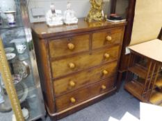 A Victorian mahogany chest of drawers, the rectangular top with rounded corners over a conforming