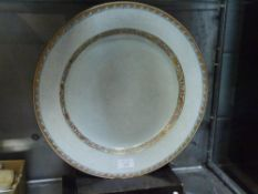 A Chinese porcelain charger, with floral decoration of pate sur pate type, highlighted with gilt