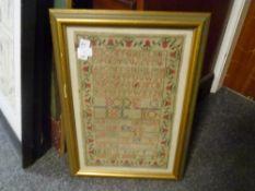 An early 19th century alphabet sampler, Margaret Reoch, 1832, framed. 43cm by 27cm