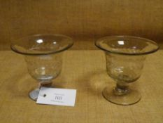 A pair of early 19th century etched glass sweetmeats, each with flared bowl, decorated with stylised