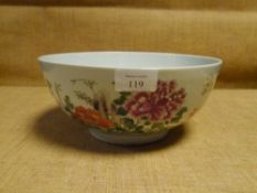 A Chinese porcelain bowl, painted in famille rose enamels with floral sprays and flowering boughs (