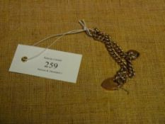 A 9ct gold curblink bracelet, with heart padlock clasp and pearl set locket charm. 13.9 grams