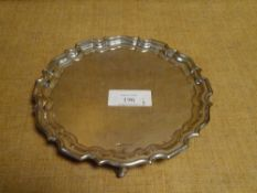 A George V silver card tray, Walker & Hall, Sheffield 1915, in 18th century style, with scalloped