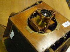 An early 20th century brass-mounted mahogany plate camera, with numbered plates, lens, focussing