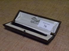 A gold (unmarked) mounted amber cigarette holder, early 20th century, in its original fitted leather