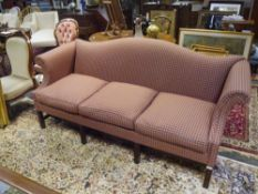 A George III style scroll-back sofa, with outscrolled arms flanking a three loose cushioned seat,
