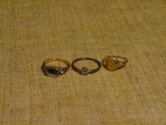 A group of ladies rings comprising: an 18ct gold signet ring; an unmarked gold ring lacking a