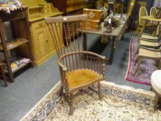 An early 19th century comb back Windsor armchair, probably Scottish, with outswept arms flanking a