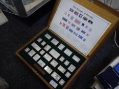 The Stamps of Royalty, a cased set of twenty-five sterling silver replicas of stamps, limited