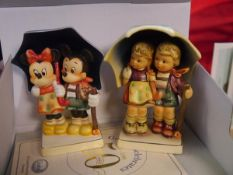 A pair of Goebel porcelain figure groups, Disney 50th anniversary, Mickey and Minnie and Rainy