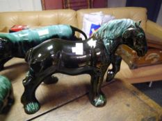 A large Canadian Blue Mountain Pottery model of shire horse. Length 52cm