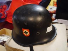 A German Third Reich police helmet, with swastika and eagle double decals, leather liner and chin