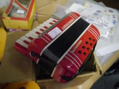 An Italian toy piano accordion, c. 1960, Castelfidardo, also marked Carbonari (some wear).