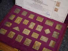 The Empire Collection - a cased set of twenty-five silver-gilt replicas of stamps, limited