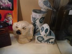 Collection of 20th century money banks including David Sharp studio pottery and Staffordshire