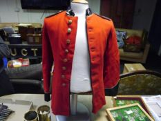 Royal Corps of Signals red tunic with brass buttons and gilt braid