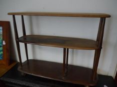 Mid 20th century Ercol elm three tier book trolley