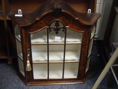 A wall mounted curio or display cabinet in period style