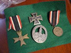 A German Third Reich medal group comprising: an Iron Cross first class, the tapering pin