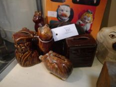 Collection of treacle glazed pottery money banks including town crier and column chest, (some af),
