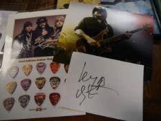 Motorhead's Lemmy Kilmister promotional photograph, a Motorhead gold edition guitar pick display