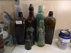 Collection of miscellaneous glass bottles including P. Loopuyt and Company distillers, Schiedam