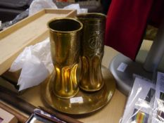"A pair of ""trench art"" brass shell canisters modelled as vases; together with a Korean War Armistice"