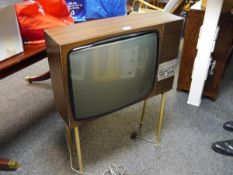 1960's Marconiphone television raised on splayed metal legs, (for decorative use only)
