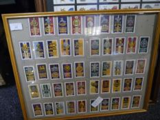 Four framed sets of vintage military cigarette cards including John Player War Decorations and