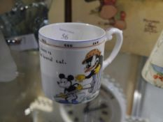 A 1930's Paragon China Mickey Mouse cup, printed of an image of Mickey holding a pop gun and the
