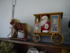 "A Steiff ""Santa's Express"", comprising horse-drawn carriage with Santa teddy, in its original wooden"