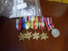 A George VI World War II medal bar comprising: the 39-45 Star; the Atlantic Star with France and