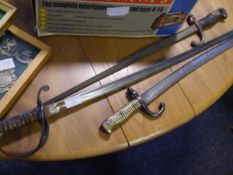 A cavalry sword with swept hilt and fullered blade; together with two bayonets (a/f)