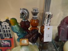 Collection of mid 20th century Avon perfume bottles including Smart Move and Siege Cannon