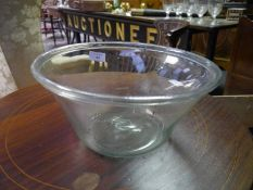 Early 19th century glass dairy bowl, with folded rim. 31cm