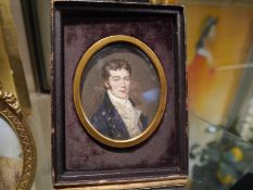 Portrait miniature of a young gentleman, c. 1820, dressed in a brass-buttoned blue coat, watercolour