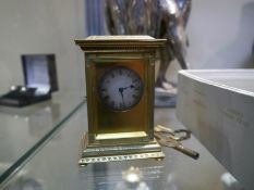 Miniature gilt-bronze mantel clock, late 19th century, of architectural form, with chased and