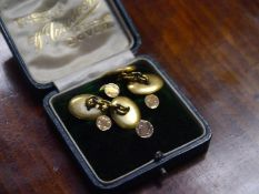 Cased set of four gentleman's 9ct gold dress studs; together with a pair of yellow metal chainlink