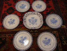 Galle, Nancy St. Clement blue and white faience dessert service, painted with the coat of arms of