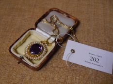 Mid-19th century gold, amethyst and seed pearl brooch/pendant, the large oval-cut amethyst within
