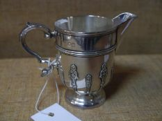 Late Victorian silver cream jug, London 1898, in early 18th century style of helmet shape applied