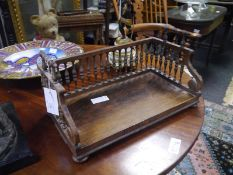 William IV rosewood book trough, c. 1835, the rectangular platform with gadrooned border and