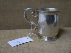 Mid-Victorian silver christening mug, London 1865, with scroll handle, engraved with a vacant