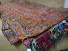Late 19th century woollen paisley shawl, in a palette of orange, green and blue, with multi coloured