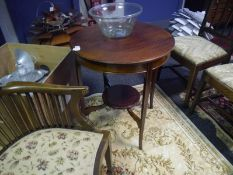 Early 20th century inlaid mahogany occasional table, of circular form, on splayed legs, joined by