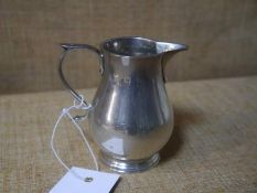George V silver cream jug, London 1920, of baluster form with scroll handle. 3.6ozt