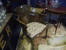 Edwardian inlaid rosewood open armchair, decorated with marks and foliate swags, on tapering