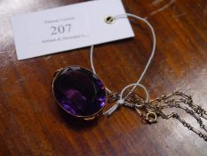 Large oval-cut amethyst pendant, late 19th century, the stone in an (unmarked) gold mount, on a