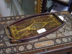 Early 20th century brass-inlaid rosewood tray, in the Secessionist taste, bearing label Craddock,